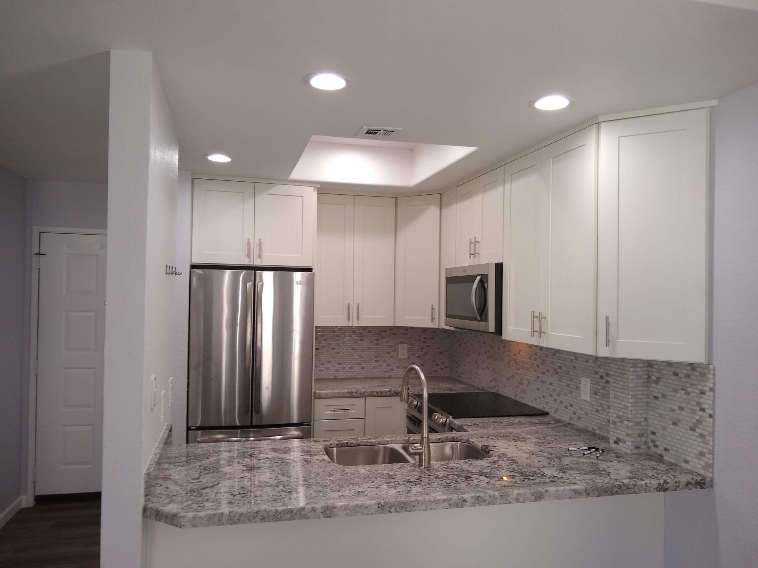 Condo, White Shaker Cabinets with Granite tops.